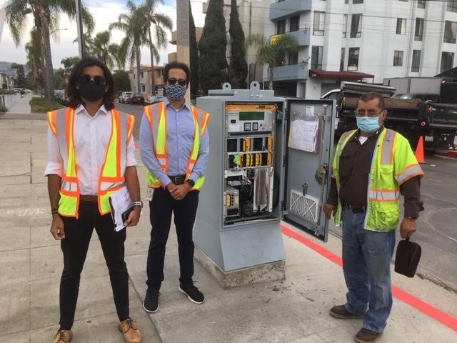 LADOT electricians pose w light switch box at Holt and Pico